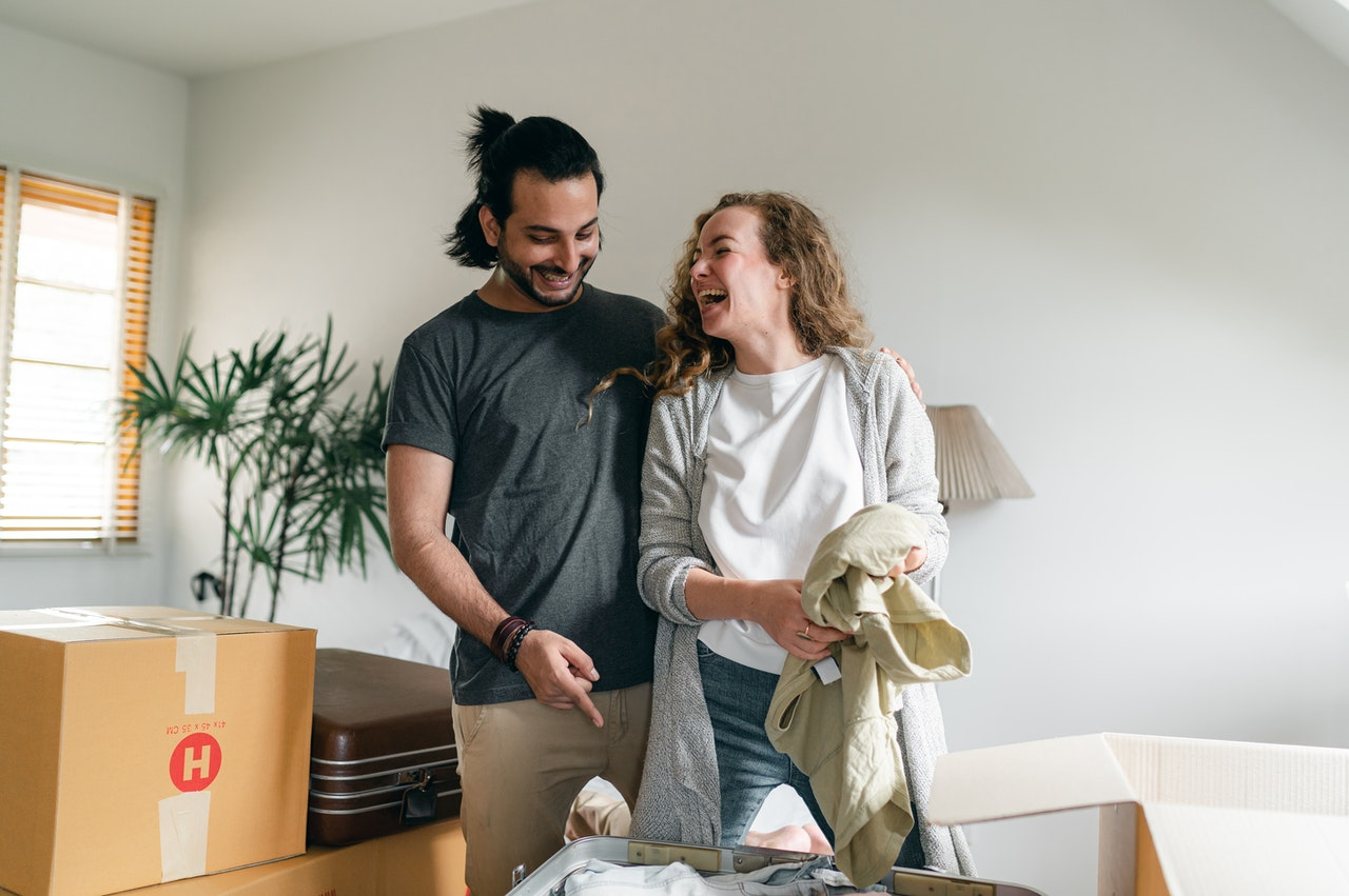 man and woman decluttering home